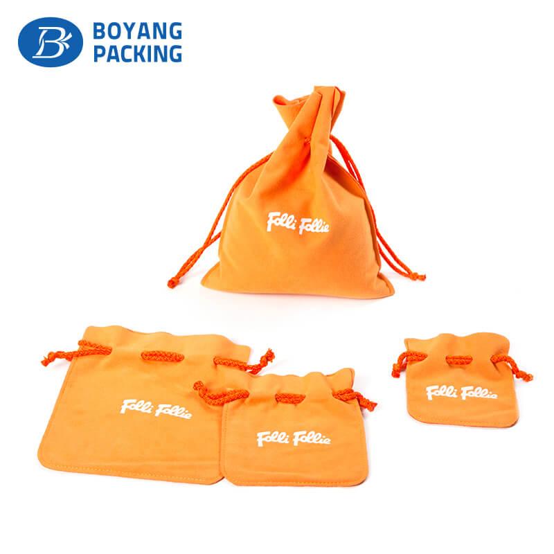 Orange velvet drawstring jewelry gift pouches wholesale