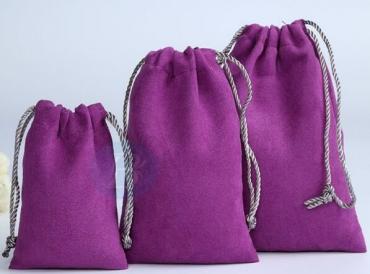 What kind of packaging material is Custom velvet drawstring bags?