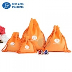 Orange velvet pouches wholesale, velvet drawstring bag suppliers